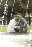 Portrait Of Couple On Fountain Edge Stock Photography