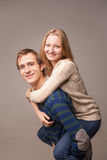 Portrait of couple, girl is on her boy's back Royalty Free Stock Photography