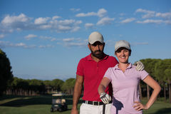 Portrait of couple on golf course royalty free stock images