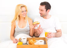 Portrait of a couple having breakfast in bed Stock Photography