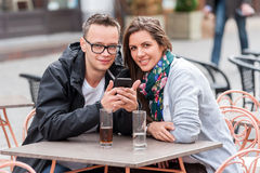 Portrait of couple having coffee at terace Royalty Free Stock Photography