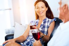 Portrait of a couple having a glass of red wine. At home royalty free stock images