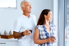 Portrait of a couple having a glass of red wine. At home stock photo