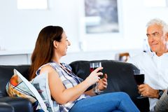 Portrait of a couple having a glass of red wine. At home royalty free stock image