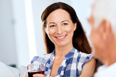 Portrait of a couple having a glass of red wine. At home stock image