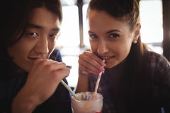 Portrait of couple having milkshake. In restaurant Stock Images