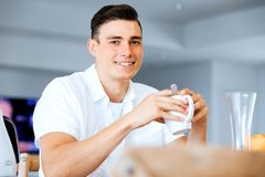 Portrait of a couple having tea at home royalty free stock photos