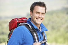 Portrait Of Couple On Hike In Beautiful Countryside Stock Photo