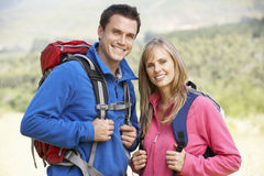 Portrait Of Couple On Hike In Beautiful Countryside Stock Photography