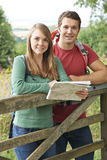 Portrait Of Couple On Hike In Countryside With Map. Couple On Hike In Countryside With Map Stock Photos
