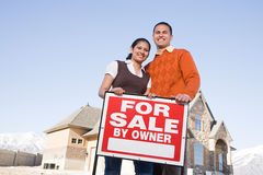 Portrait of a couple hold a for sale sign Royalty Free Stock Image