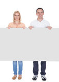 Portrait Of Couple Holding Blank Placard Royalty Free Stock Photo