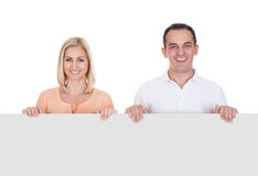 Portrait Of Couple Holding Blank Placard Royalty Free Stock Photos