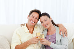 Portrait of a couple holding flutes of champagne Royalty Free Stock Image