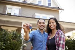 Portrait Of Couple Holding Keys To New Home On Moving In Day royalty free stock image
