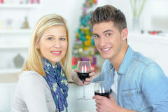 Portrait couple holding wineglasses Stock Images
