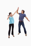 Portrait of a couple jumping together Stock Image