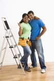 Portrait of couple with ladder. Stock Photo