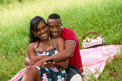Portrait Of Couple Listening To Music On Mobile Phone Royalty Free Stock Image