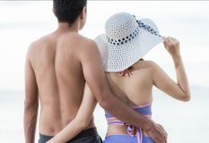 Portrait Couple, looking at recreation tropical beach. At Thailand Stock Photo