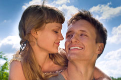 Portrait of a couple in love. Married couple (in love) on a nature background Royalty Free Stock Photography