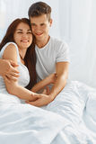 Portrait of couple in love in bed Stock Photography
