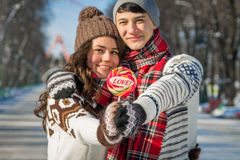 Portrait of couple in love holding lollipop Royalty Free Stock Photos