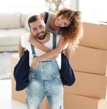 Portrait of a couple in love in a new empty apartment. Couple in love in a new apartment. Concept of real estate Stock Image