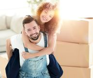 Portrait of a couple in love in a new empty apartment. Couple in love in a new apartment. Concept of real estate Royalty Free Stock Photography