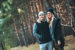 Portrait of couple in love standing in beautiful forest hugging and smiling. Family spending time in outdoor. stock images