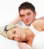 Portrait of a couple lying in bed Stock Images