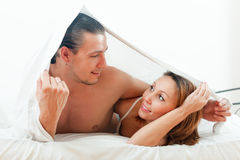 Portrait of couple lying  in bed Stock Photography