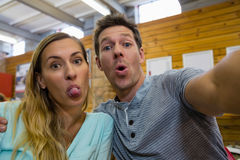 Portrait of couple making faces in cafe Royalty Free Stock Photo
