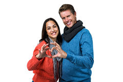Portrait of couple making heart shape with hands Stock Photography