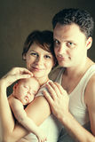 Portrait of couple with newborn daughter Royalty Free Stock Photography