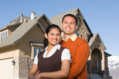 Portrait of a couple outside of a house Royalty Free Stock Images