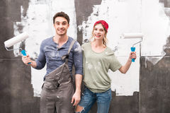 Portrait of couple with paint rollers Royalty Free Stock Photos