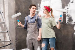 Portrait of couple with paint rollers Stock Images