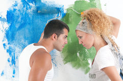 Portrait of couple painting at home stock photo