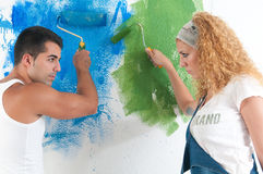 Portrait of couple painting at home royalty free stock image