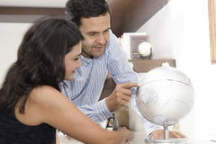 Portrait of couple planning vacation Royalty Free Stock Photos