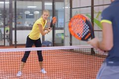 Portrait couple playing paddle tennis Royalty Free Stock Images