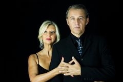 Portrait of a couple of professional tango dancers. Royalty Free Stock Images