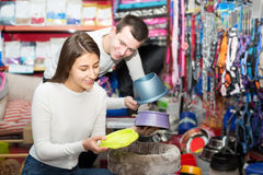 Portrait of couple purchasing pet bowls in petshop Royalty Free Stock Image