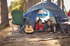 Portrait of couple relaxing in tent Stock Photo