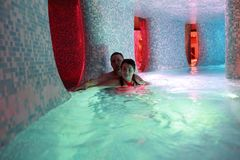 Couple relaxing in water park. Portrait of couple relaxing in water park Stock Images