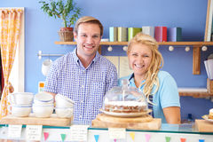 Portrait Of Couple Running Cafe Together Stock Photography