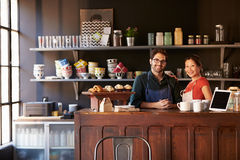 Portrait Of Couple Running Coffee Shop Behind Counter stock photos