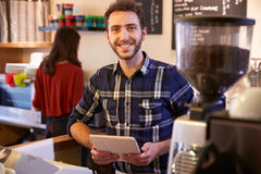 Portrait Of Couple Running Coffee Shop Together Royalty Free Stock Photos