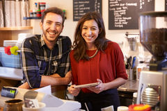 Portrait Of Couple Running Coffee Shop Together Royalty Free Stock Images